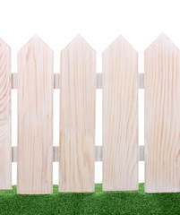 wooden fence and green grass isolated on white.