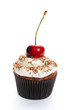 Cupcake with whipped cream and cherry