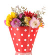 Red bucket with white polka-dot with flowers isolated on white