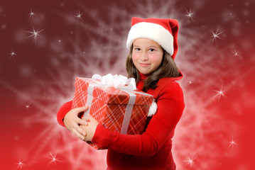Little girl with santa hat and box