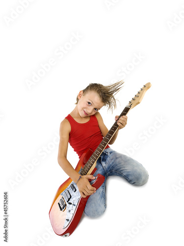 Rockstar kid with electric guitar