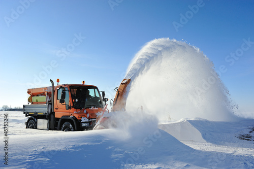 snow blow cleaning road