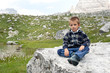Portrait of 4 years kid outdoors in the mountains.