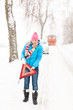 Woman with reflector triangle car snow breakdown