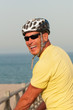 Smiling man wearing a cycling helmet
