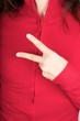 two fingers symbol on red sweater
