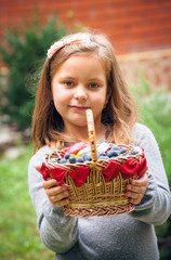 lovely girl with the basket of ecological fruit