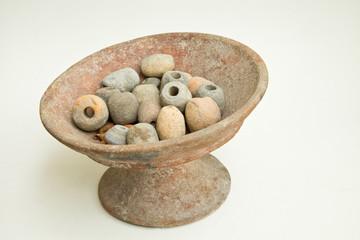 Clay tray and stone bead