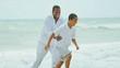 Ethnic parent enjoying son time by ocean