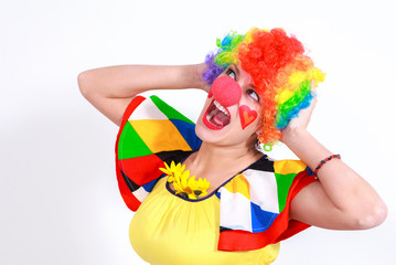Clown looking to the copy space area in a white studio