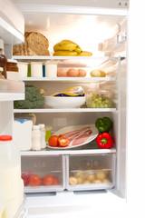 full up fridge with open door