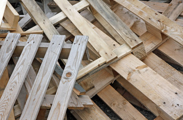 pile of wooden pallets for transportation of material