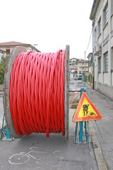 roadworks and a coil of wire with the excavation