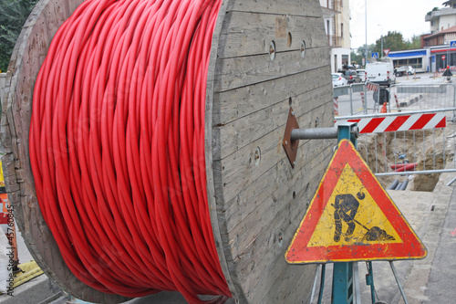 roadworks and a coil of wire with the road sign