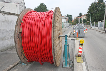 spool of cable and fiber optics in the road during the outdoor a