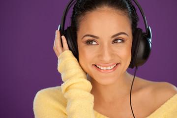 Smiling woman enjoying her music