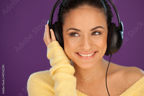 Smiling woman enjoying her music