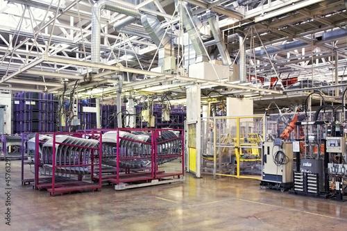 robots in a car factory - 45763291