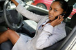 Woman talking on her mobile phone in her car