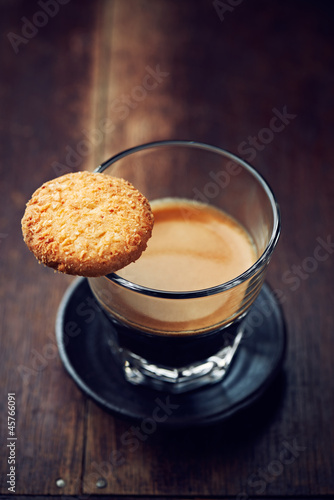 Glass of espresso with biscuit
