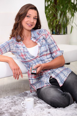 Woman with a remote control