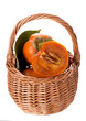 persimmons in a basket on a white background