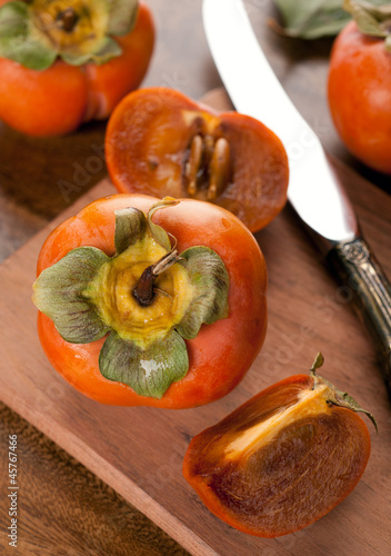 persimmon on a wooden table
