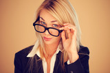 Businesswoman peering over her glasses