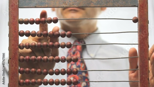 businessman with abacus over white background