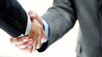 Businessmen handshake two men shaking hands