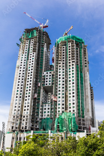 high building under construction with working crane