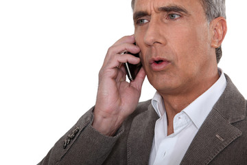 mature man at phone having trouble