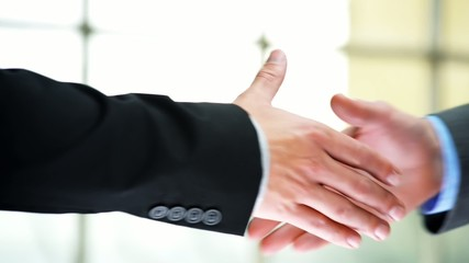 Car rental agreement handshake