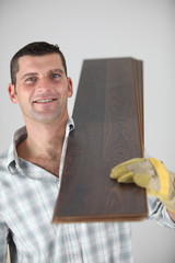 craftsman carrying wooden boards