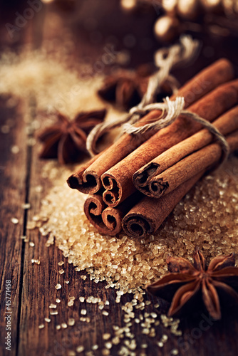 Cinnamon sticks and star anise on brown sugar