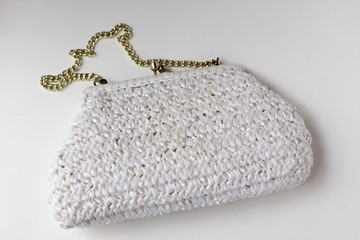 white woven handbag against white background