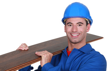 Man holding laminate floor panel