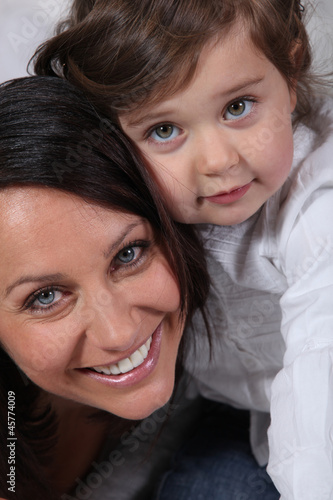Portrait of little girl and her mum