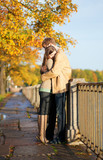 Couple in love tenderly hugging on the Fontanka embankment in Sa poster
