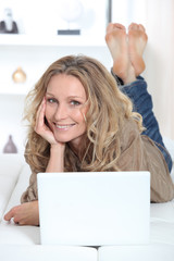 Casual woman using a laptop