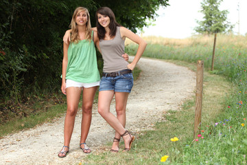 Couple of girls standing on a county path