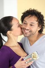 Boyfriend offering gift to girlfriend