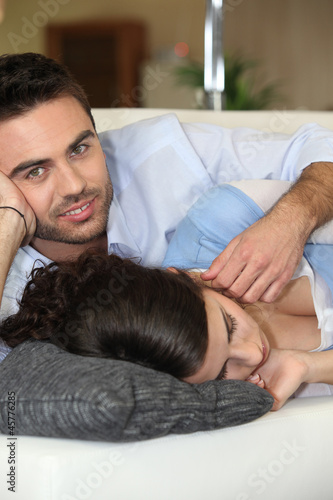 Man caressing his sleeping wife