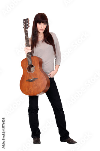 female artist posing with guitar