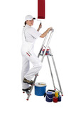 Female decorator painting a wall