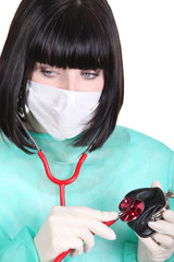Female doctor with stethoscope and wallet