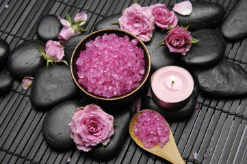pink rose with salt in bowl and candle on mat