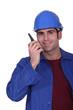 Construction worker speaking into a walkie-talkie