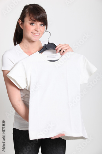 Girl with a white t-shirt on a hanger