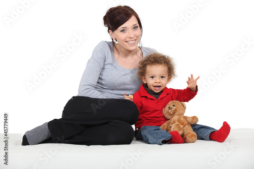 Mother sat with little boy and toy bear